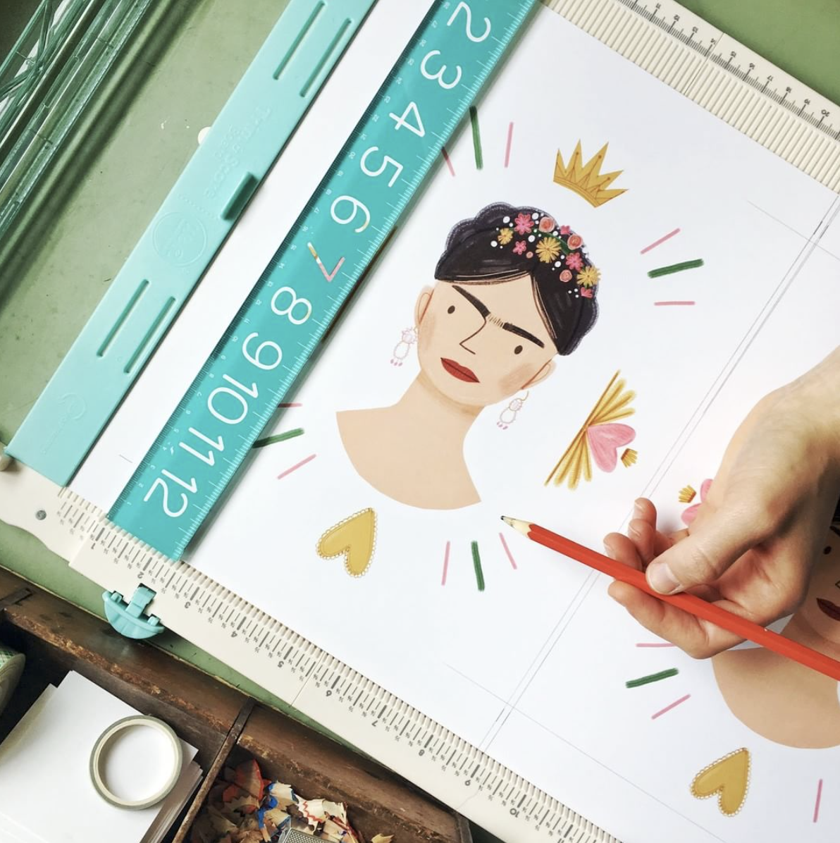 Cutting out a Frida Kahlo print in the Aviate Press art studio