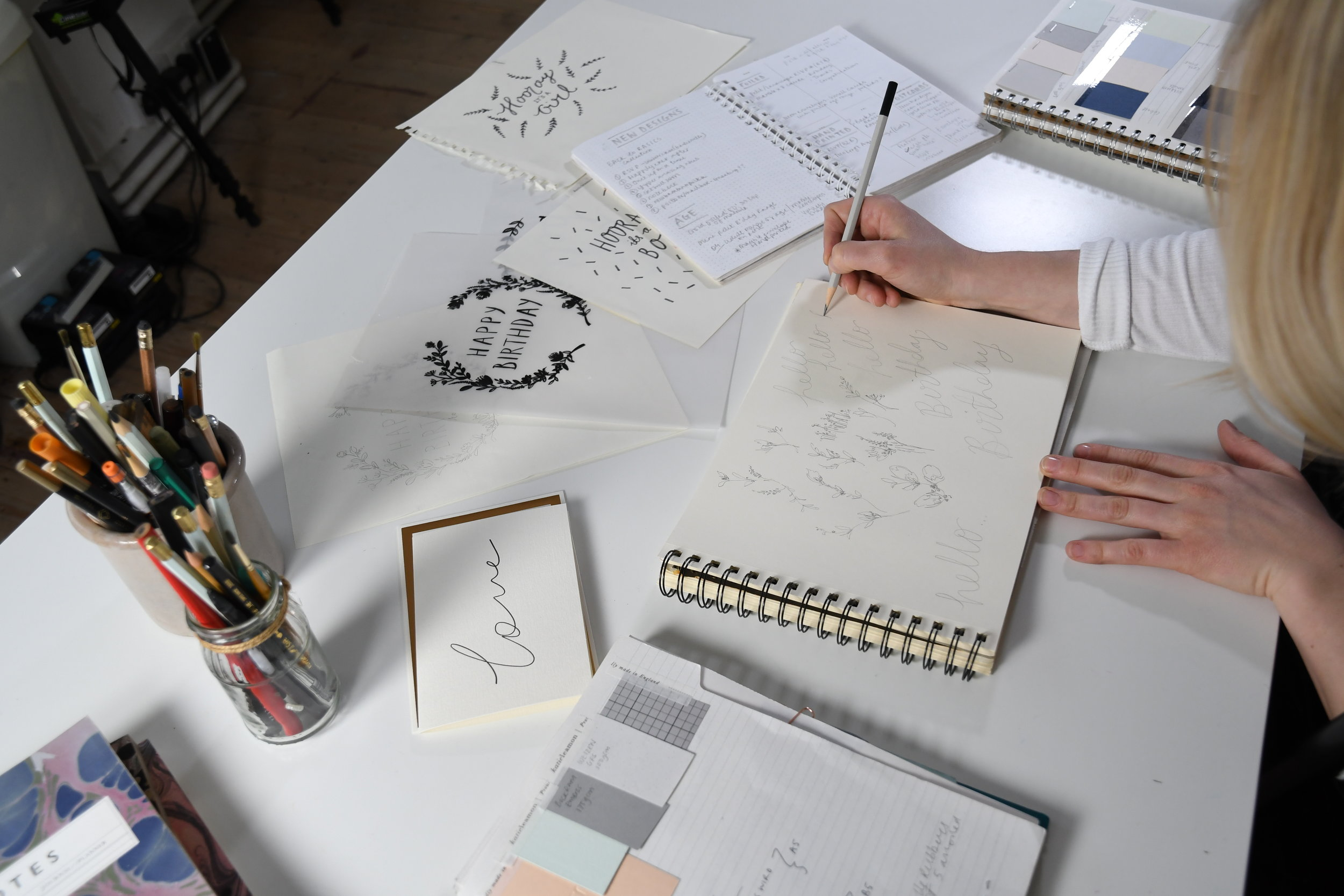 Katie Leamon drawing in her London England studio