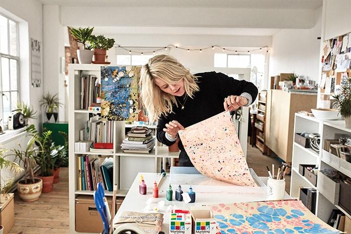 Katie hand marbling paper in her London studio