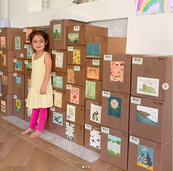 Jennifer Lee Gregoire's daughter in front of card boxes from the printer
