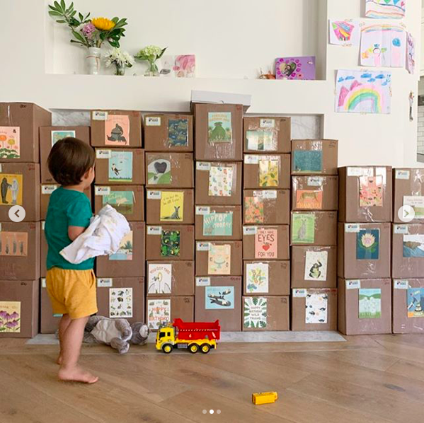 Jennifer Lee Gregoire's son in front of card boxes from the printer