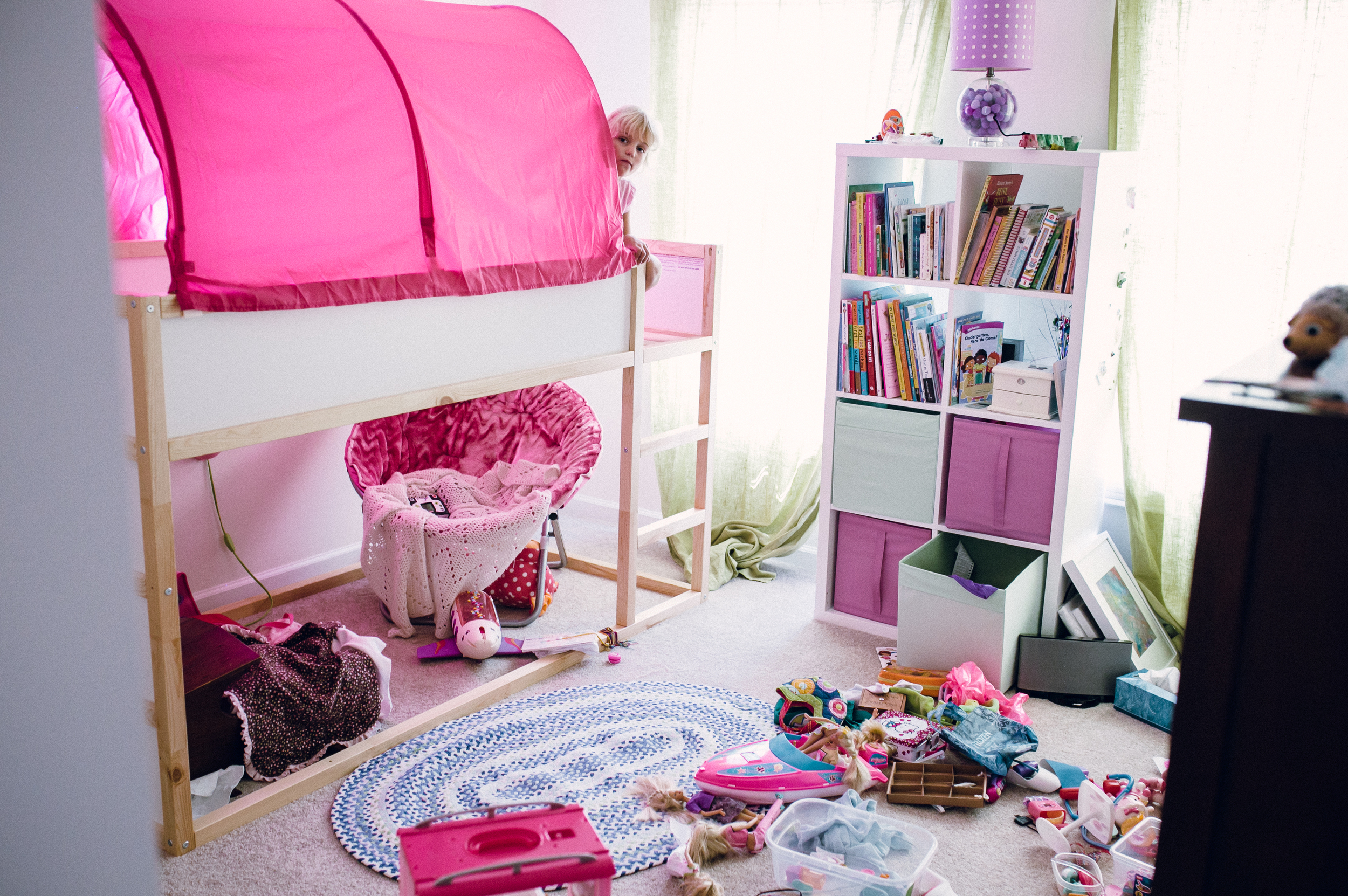 A little girl in her bedroom in Bel Air MD. Family photography in Baltimore, Annapolis and Harford County Maryland.