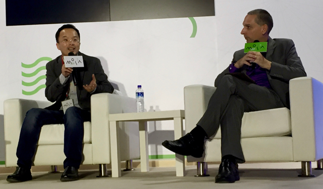 Matt Huang on stage with Bloomberg's Tim Culpan at MOSA