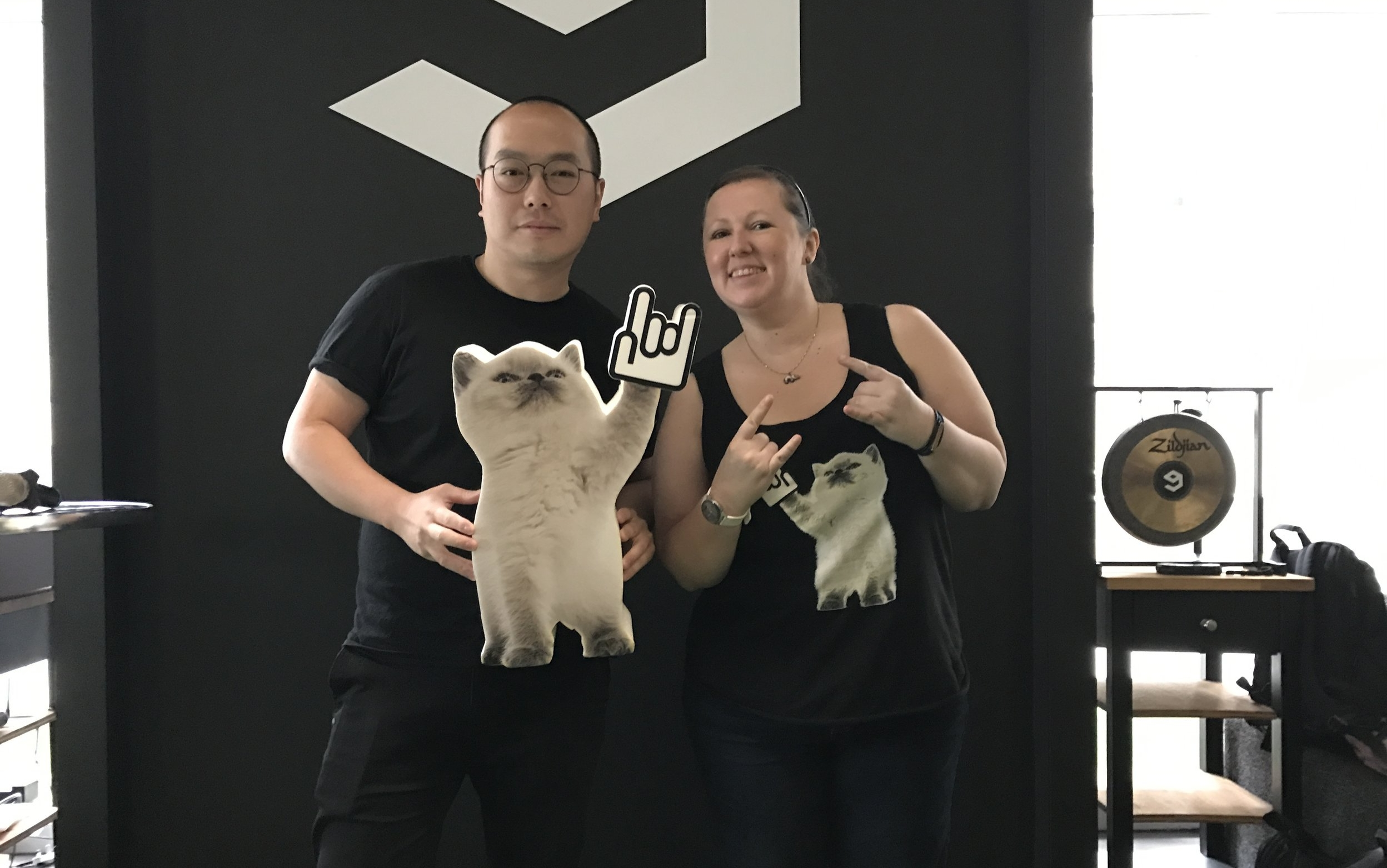 TSS General Manager Holly Harrington Presents giant todd the rock cat to 9GAG CEO Ray Chan