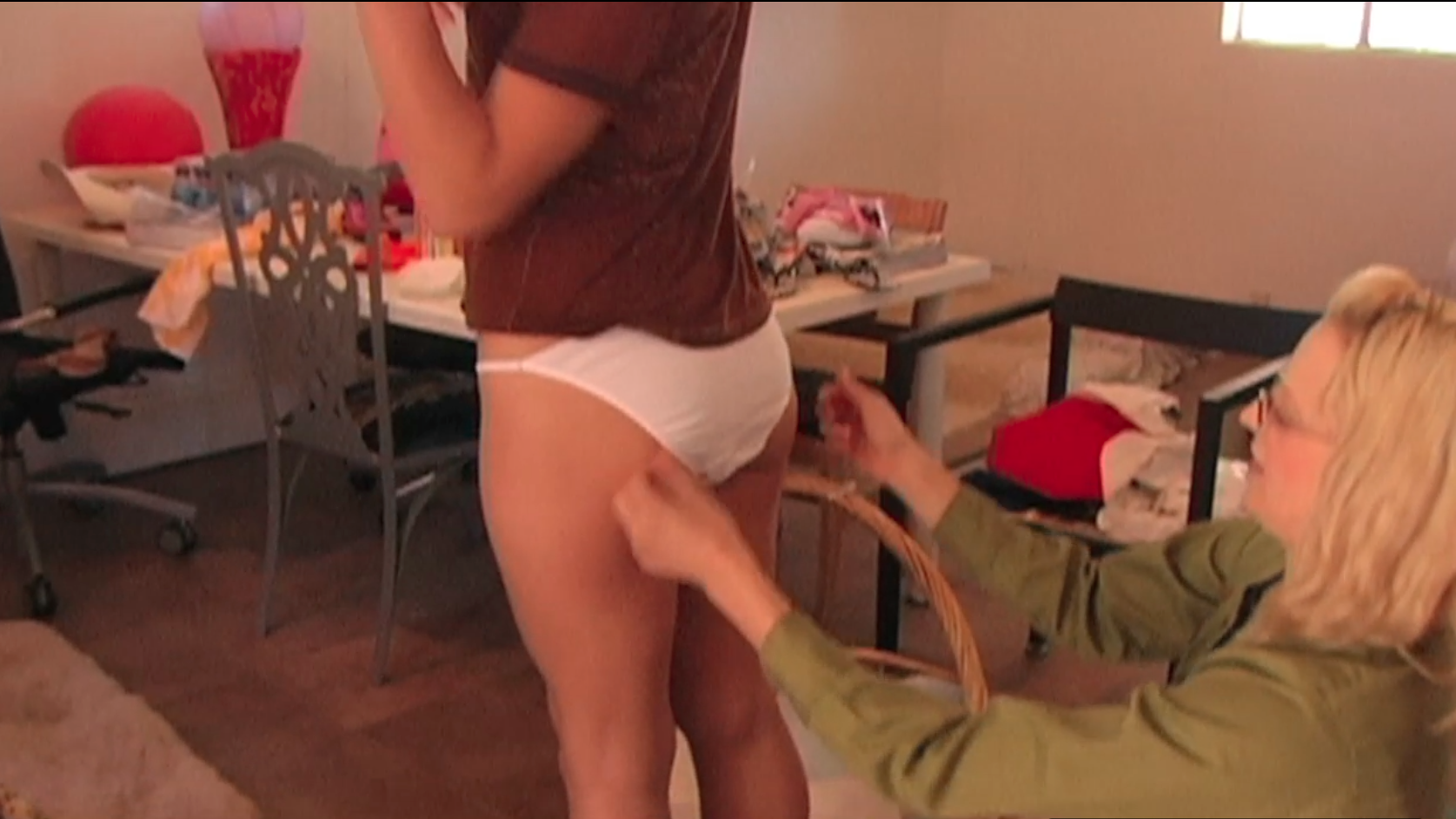 BARELEY LEGAL ADULT VIDEO ACTRESS TRYING ON THE ICONIC WHITE PANTIES. PHOTO BY JENNA ROSHER
