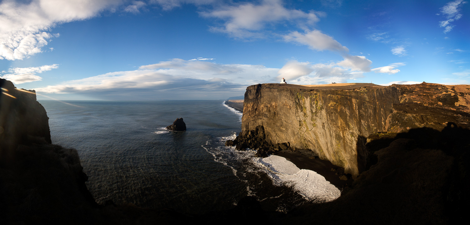 Massive Rock Formation with the Dyrhólaey Lighthouse on top, Iceland