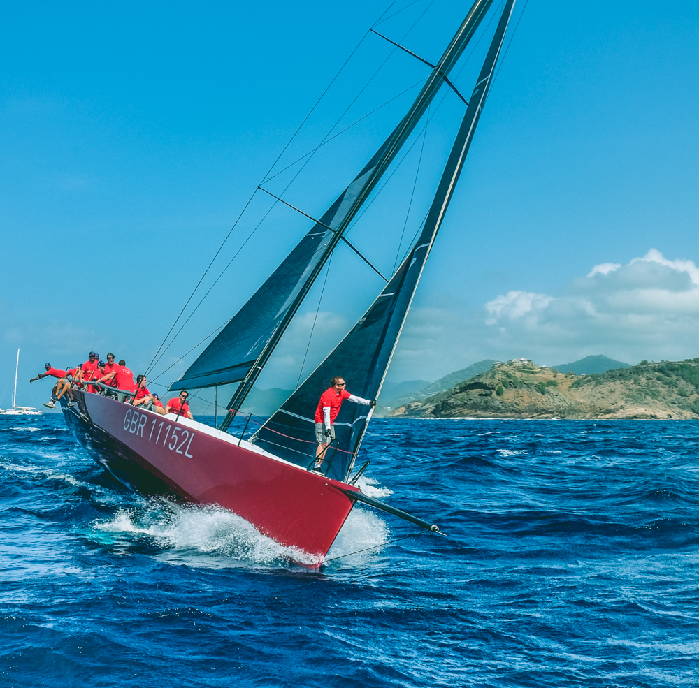 Sailing the Antiguan Seas - Antigua's waters are home to some of the fastest yachts afloat. And you can be cranking the jib on a racing crew