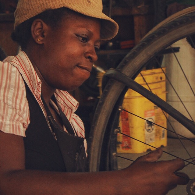 While the bikes are enjoying a relaxing cruise across the Atlantic, probably dancing all nite and eating shrimp, we'd like to introduce you to Mirriam Agyeiwaa. She's one of the amazing mechanics at Ability Bikes in Koforidua, the capital of the Eastern Region of Ghana. They're a bike co-op run by seven super folks who happen to have disabilities. It's also the final destination for the @goodcontainer. Here, the bikes will be repaired and distributed to the community. Mirriam is a beautiful person, and we love she digs straightening rims as much as we do. Go on, Mirriam. We're coming with a boatload of bikes and can't wait to finally meet!! // Photo: Derek McIntire