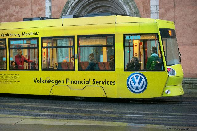 A Volkswagen Financial Services AG advertisement sits on the side of a passenger tram in Braunschweig, Germany, on Thursday, Oct. 22, 2015. The towns that became synonymous with Volkswagen AG's rise to the pinnacle of the auto industry are feeling the pinch of the diesel-emissions scandal, freezing spending on projects such as playgrounds amid the carmaker's abrupt fall from grace. Photographer: Krisztian Bocsi/Bloomberg