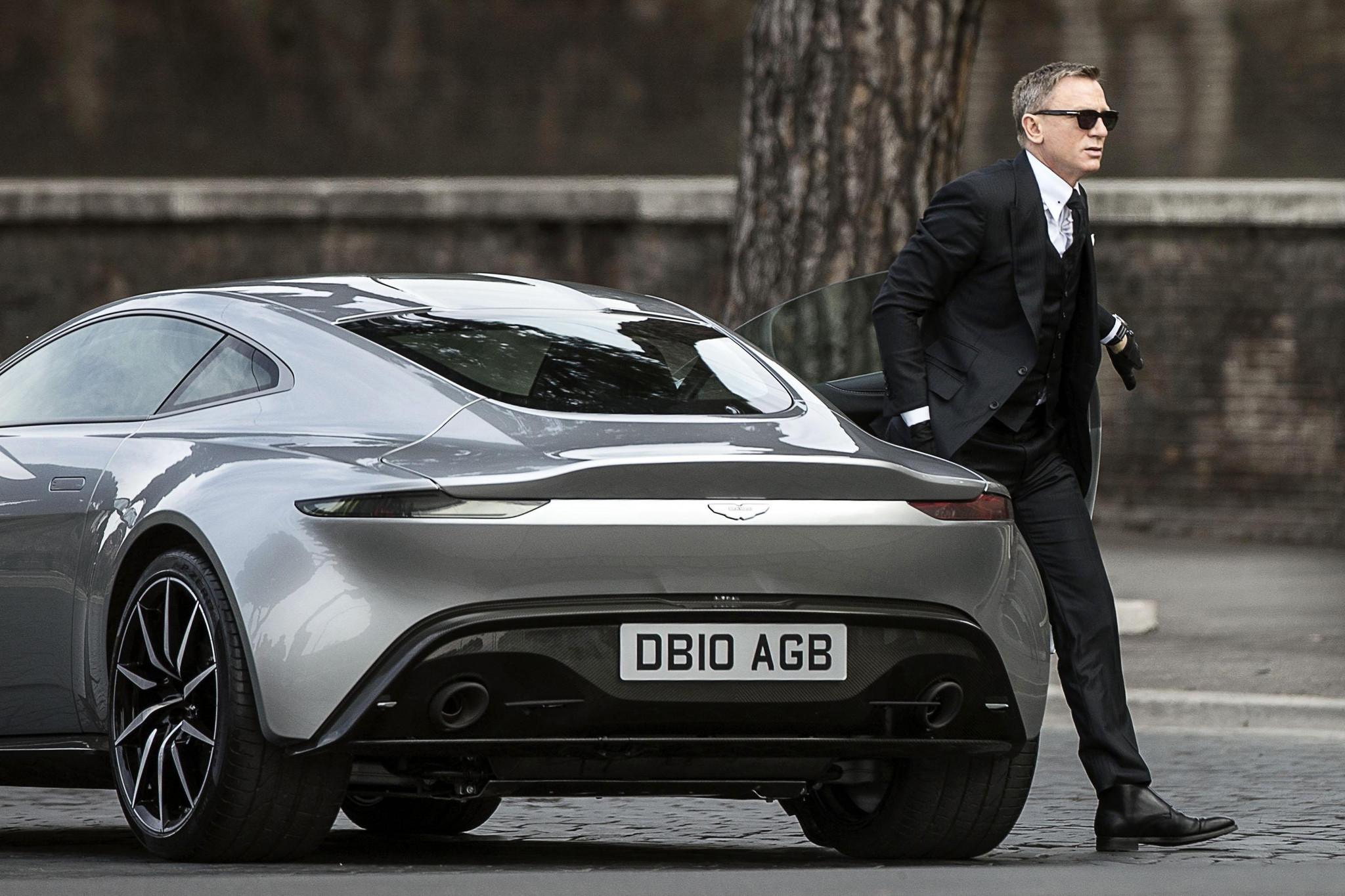Bond walking away from his all new Aston Martin DB10