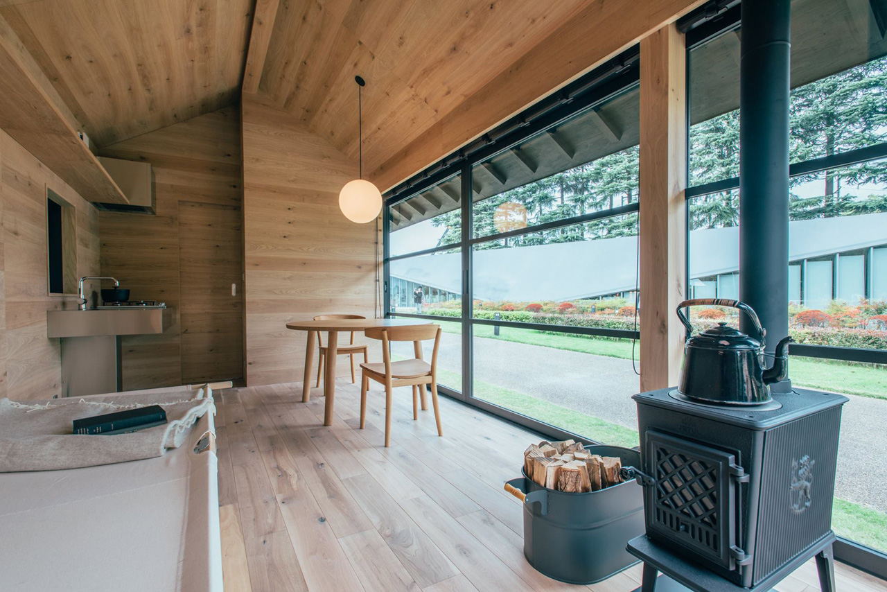 MUJI Hut prefab home designed by Jasper Morrison.Morrison's cork-clad structure features zones for cooking, eating, sleeping, and washing up.