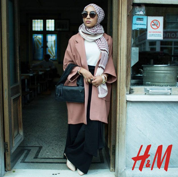 H&M's 2015 Fall collection was led by Maria Hidrissi, dressed in round sunglasses, black palazzo pants, a pink coat, and a checked hijab.The campaign is a step away from stale family stereotypes in acknowledging diversity in the women's market.