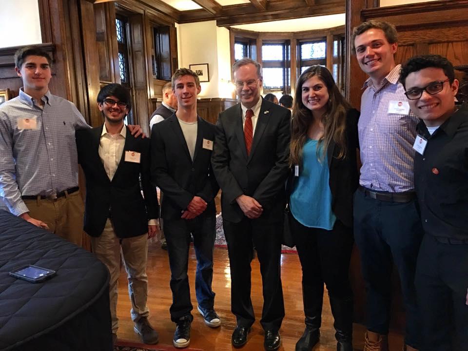 Eric Cola, Gabriel Ortiz, Will Carrara, Chancellor Kent Syverud, Shira Stoll, Elliot Greenwald, and Christian Merced Cruz at the Chancellors house in Syracuse, NY.