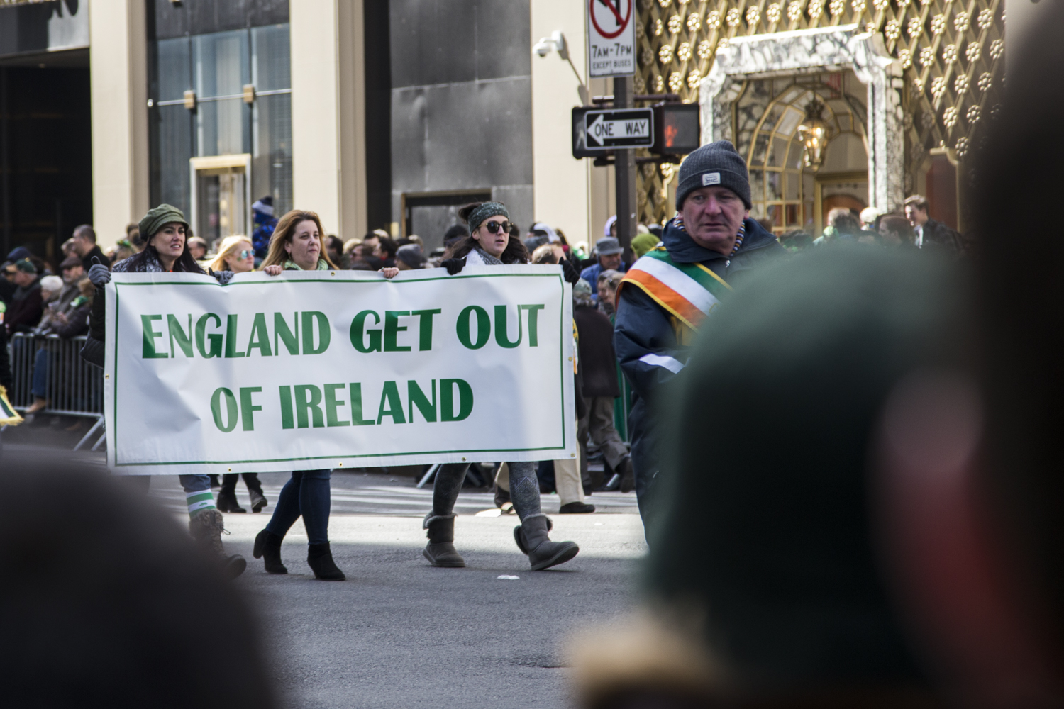 """Women marching in the St. Patrick's Day Parade in Manhattan and holding a sign which reads """"England Get Out of Ireland."""" (Staten Island Advance/Shira Stoll)"""