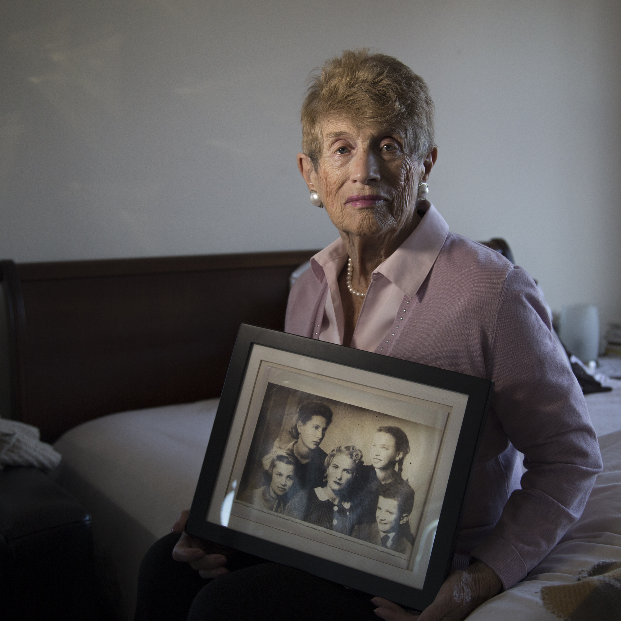 Holocaust survivor Rachel Roth holding the only photo she has of her mother and three siblings. They were all killed in Treblinka after living in the Warsaw Ghetto in Poland.