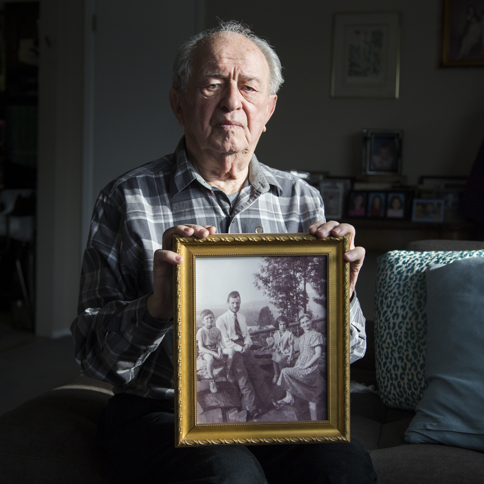 Holocaustsurvivor Arthur Spielman holds a photograph of his family just before the World War II broke out. The whole family survived, living with fake Roman Catholic papers in Hungary, but he lost all of his extended family in theHolocaust.
