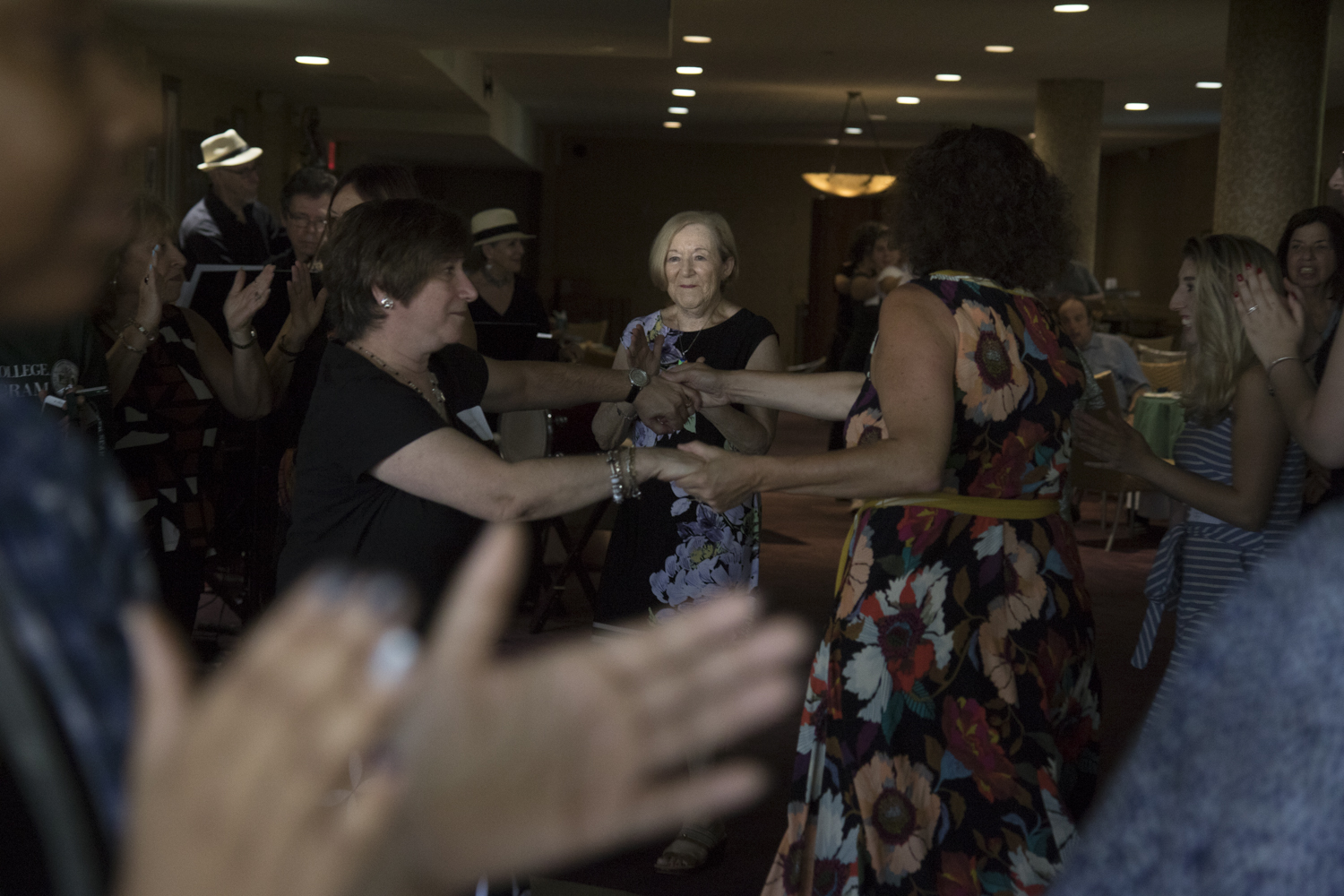 Holocaust survivor Brenda Perelman is illuminated at the Rosh Hashanah Lunch at Wagner College. Students, Holocaust survivors and Jewish community members dance to the Tsu Fil Duvids Klezmer Ensemble music on Sunday, Sept. 13, 2018.