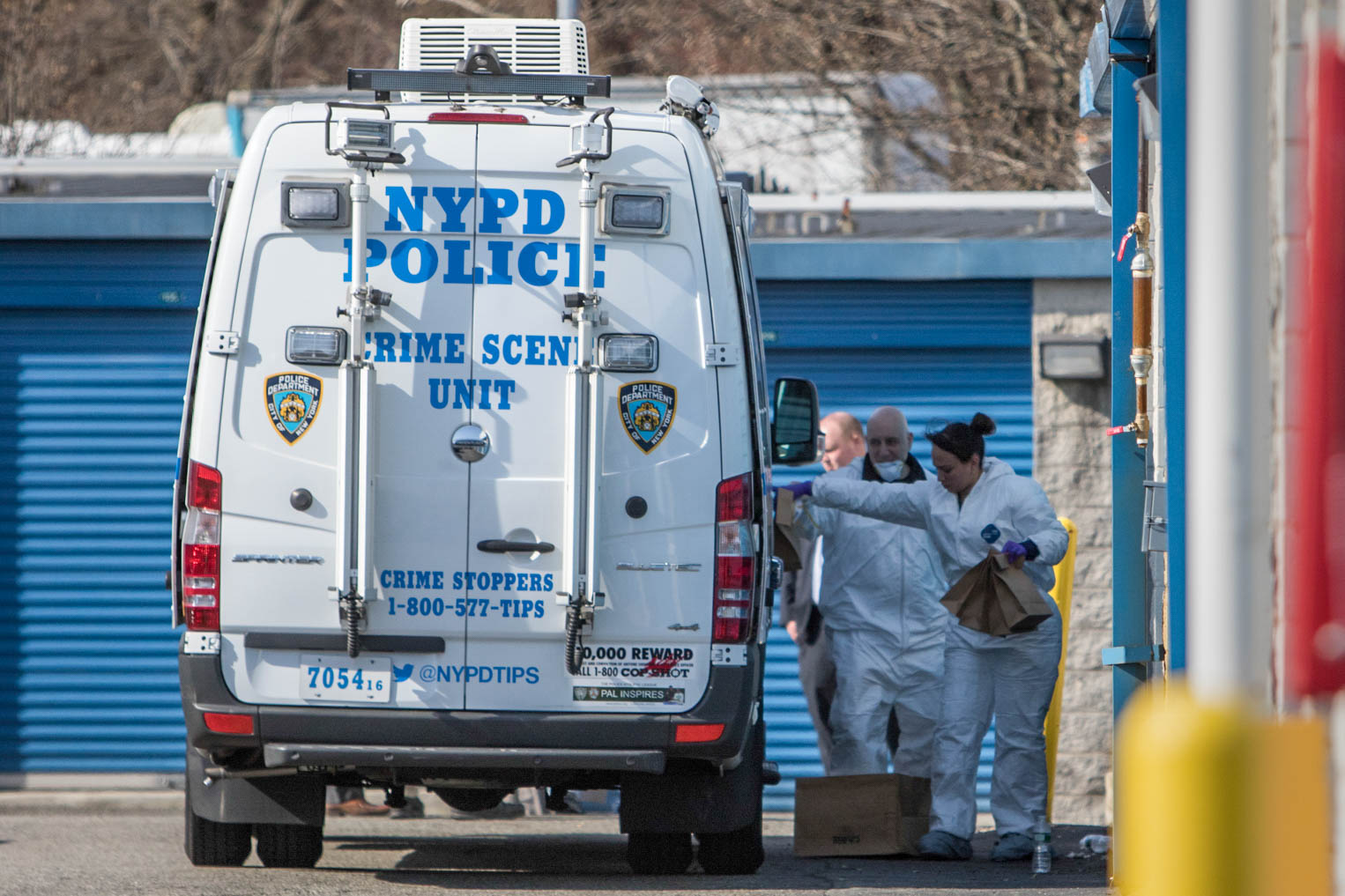 Police found charred human remains in a Staten Island storage unit at Extra Space Storage in Arden Heights on Thursday, April 4, 2019. The remains were confirmed by police to be a missing teacher, Jeanine Cammarata. Crime Scene Unit officers are pictured here carrying brown paper bags filled with apparent evidence collected at the storage facility.