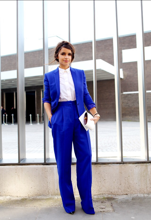 A bright jewel colored suit is a fabulous way of working two trends simultaneously. By teaming a simple white shirt it allows the suit to do all the talking. Try adding a white element (classic white shirt) when color blocking, to compliment the array of colors.