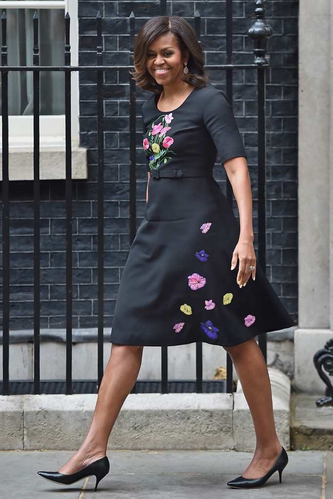 Mrs. Obama walking the streets of London wearing Christopher Kane's Fall 2015 collection looking effortlessly chic.