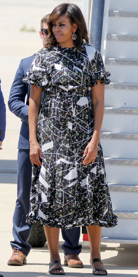 First Lady looking effortlessly chic in Madrid, Spain wearing a black floral graphic print dress.