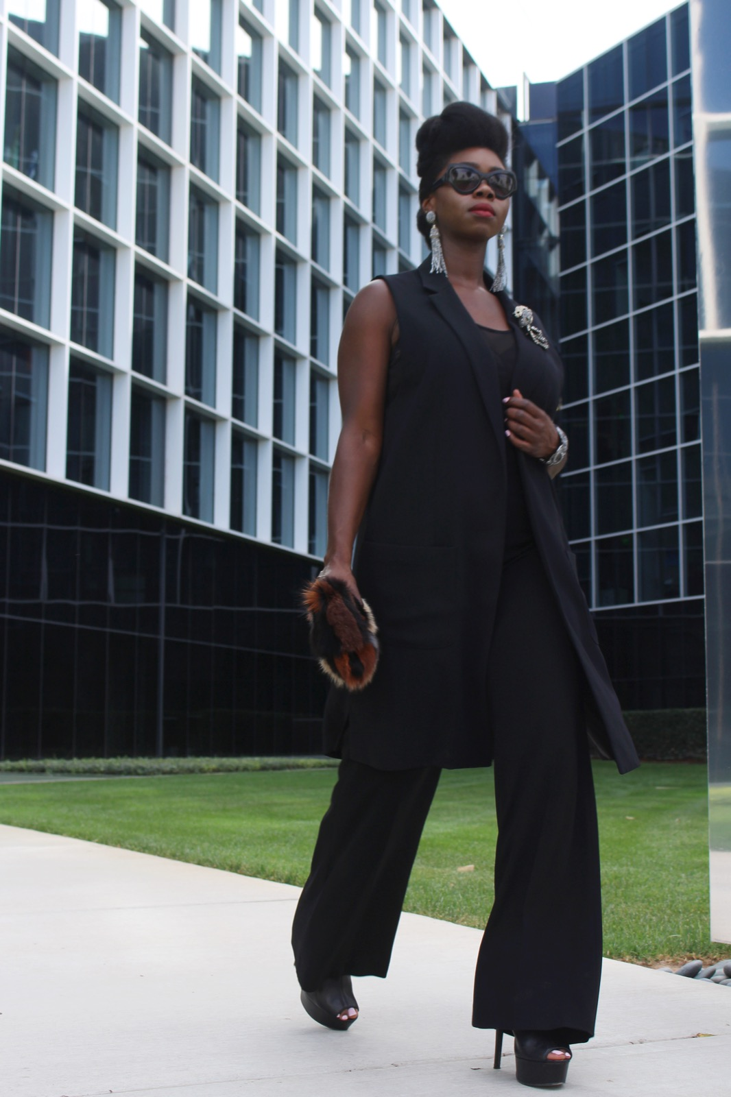 Sleeveless long vest:  Topshop |  Body Suit: Asos (old) | Wide leg trousers:  Eileen Fisher | Open toe platform shoes: Stuart Weitzman |  Faux Fur clutch:  Express (old)  seen here   | Bracelet: Versona | Earrings & brooches:  Natasha, Dillards | Shades: YSL.