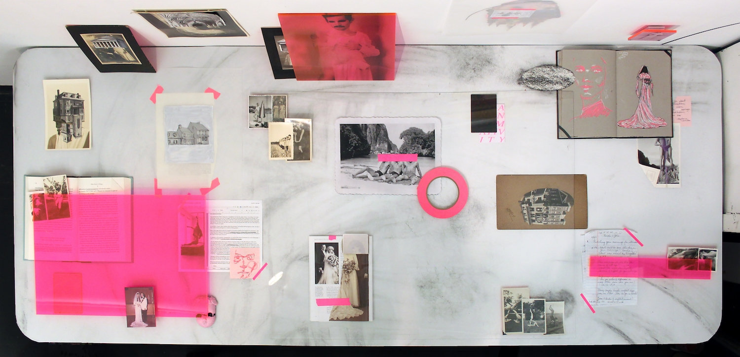 Amatonormativity (First State), 2017, archival ink jet prints, table, books, plexiglass, charcoal on paper, collage, found photographs, vinyl, & tape, dimensions variable