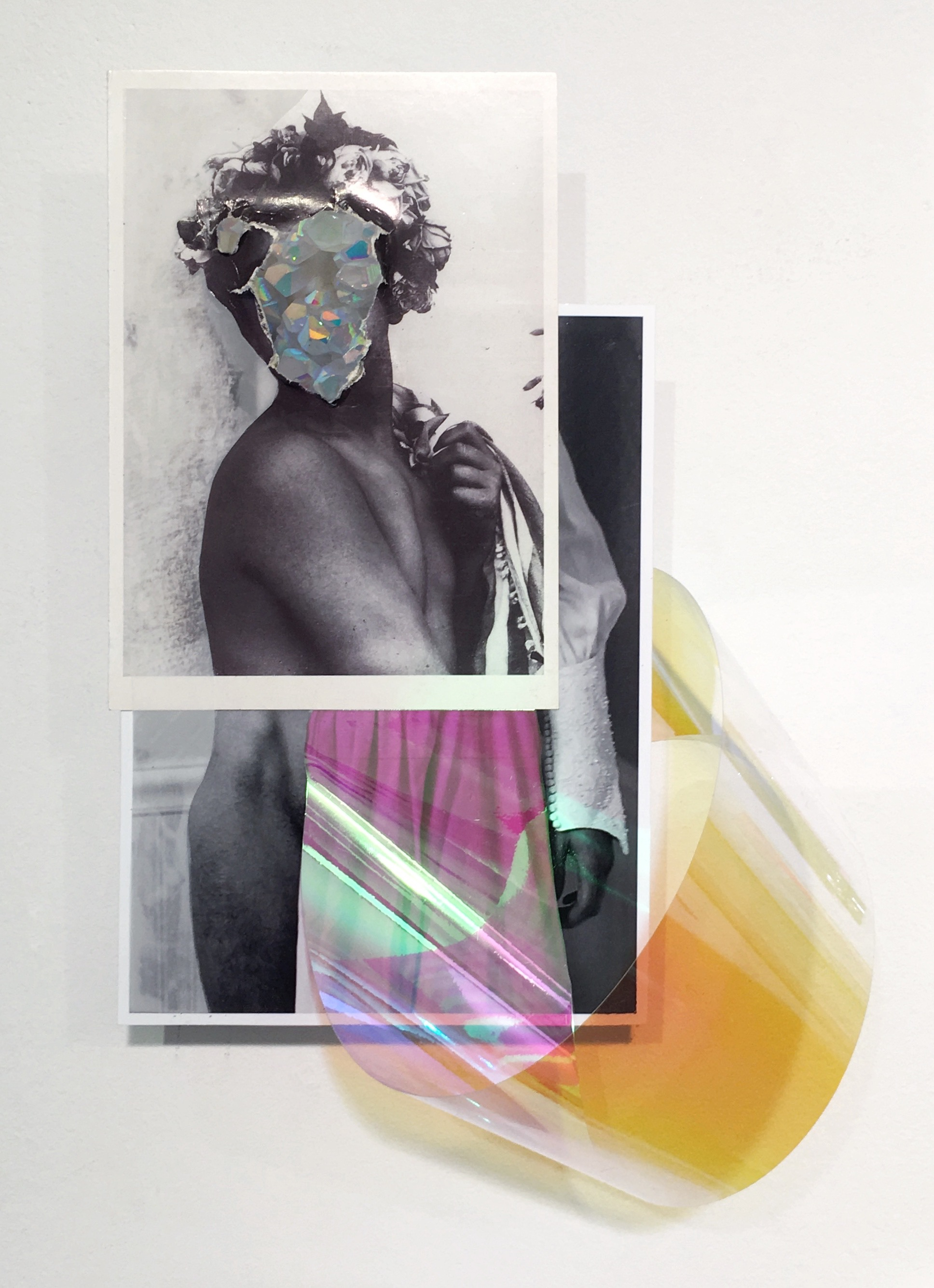Untitled (Möbius strip tease), 2018, Collaged photographs, postcards, tape, vinyl, and crystal, 10 x 5 inches (variable).