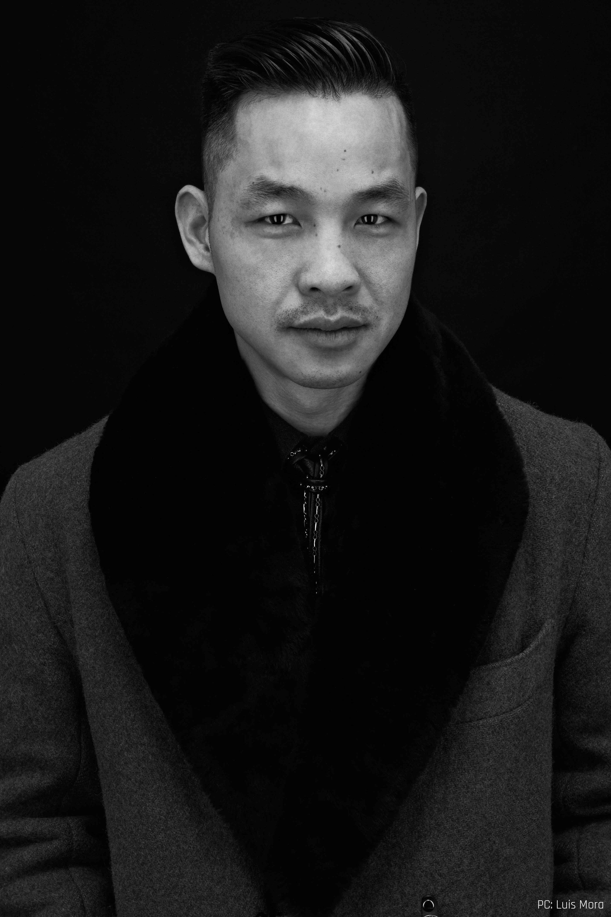 "Founder/Creative Director    Founder and Creative Director, Ken Chow graduated from the prestigious Fashion   Institute of Technology's (FIT) menswear program in New York. While at FIT, he interned with internationally-renowned designers Marc Jacobs, and Robert Geller and Alexandre Plokhov – the team behind the NY cult label Cloak(now defunct). During his time in New York, he also won the opportunity to show his modern take on menswear through GenArt's high-profile International Design Competition.  Upon Chow's return to Toronto in the early 2000's, he felt the excitement happening in the women's accessories market and foresaw the same excitement happening in the men's market – pertaining to bags, or the coined term ""manbags"". Chow devoted his focus on developing and perfecting his craft; working with specialized Canadian artisans from the handbag industry.  Entering the men's market with a reinterpretation of an old classic – the waxed cotton and leather carry-all, the Krane Bag caught the attention of international media and buyers. Men soon elected his utilitarian manbags as a fashionable necessity; paving the way for the introduction of the Krane Man menswear line.  Chow was born in China surrounded by pencils, paint brushes, and pins and needles – tools that would foreshadow a later stage in Chow's life.  Once in Canada, Chow honed his gift of drawing; entering Remembrance Day/Veterans' Day poster design contests and sparking an interest in a militarist aesthetic, a recurring theme which continues today. His love for music, art, architecture, and street-culture add the modern influences to the collections.  A lover of all things Asian, Chow followed through with this in deciding on the name, Krane, for his label: a combination of what the crane bird represents in Asian symbolism; Daniel-san's winning karate style in the Karate Kid; and the industrial crane (which is the later western influence).  Chow currently resides in Toronto, Canada, a city rich and diverse in music, art, architecture, youth and street culture."