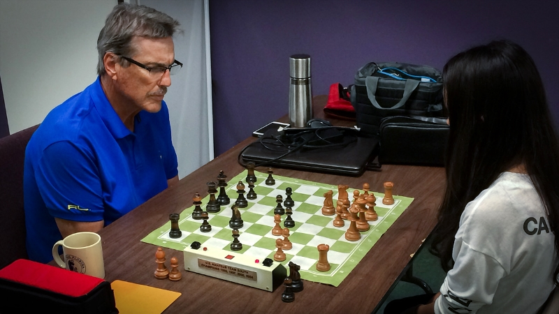 USCF Life Master Larry Storch picks up a recreational game with Camille S.
