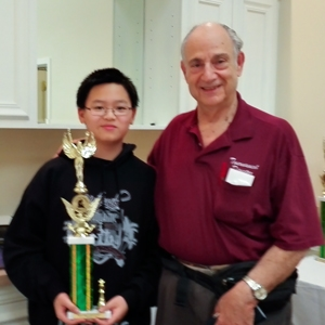 Benjamin Chen (1402) (L), all the way from Tallahassee, FL., ties for 1st Place in the Class D section, pictured with CFCC National Tournament Director and Event Organizer Harvey Lerman (R).