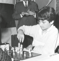 Josh playing a junior match game against Cathy Forbes