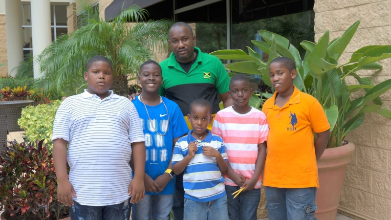 5 Scholastic players with their chess coach who traveled to the tournament from Jamaica!