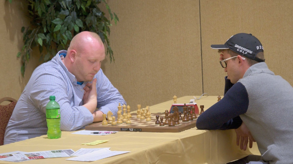 Final Round, Board 1, Tampa's Corey Acor (L) (2397) vs Texas GM Vladimir Belous (R) (2689), where their game ended in a draw, giving Corey a final score of 3.5 points and Vladimir 4.0 points and the tie for 1st place.