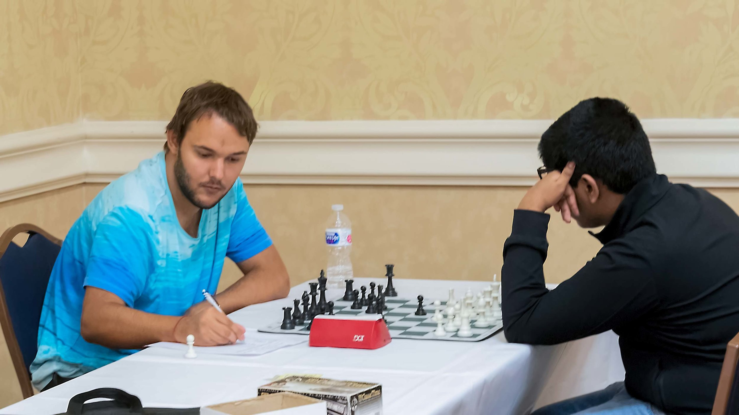 Final Round, Board 1: Martin Hansen (2221) (L) vs Abhimanyu Banerjee (2174) (R), where Martin won and tied for 1st place in the Premier section.