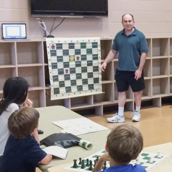 Tireless chess enthusiast Jonathan Lee teaching the 2-Queen Mate at Oviedo's Riverside Park in 2015.