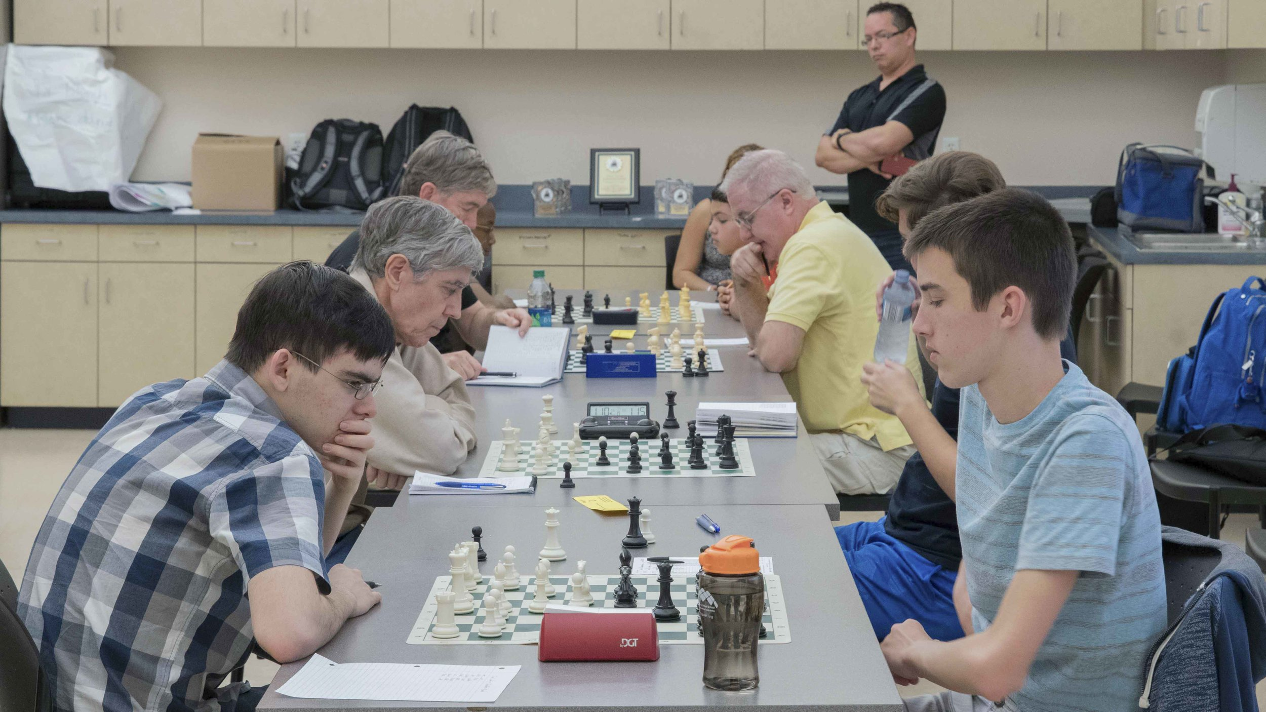 Round 4, Board One, John Ludwig (2463) (L) versus Theo Slade (2177) (R) during the CFCC Club Championship hosted by the UCF Chess Club.