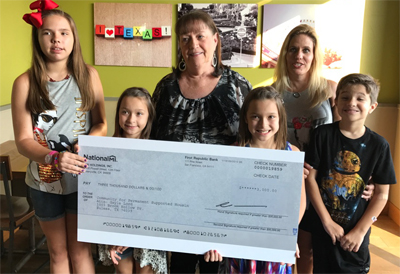 Gayle Lord, Senior Underwriter, National Mortgage Insurance, family and friends Presents a $3,ooo check to CPSH for Matching donations on North Texas Giving Day 9.14.17