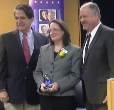 Robin receiving the Vision award for her work on behalf of those who need housing.