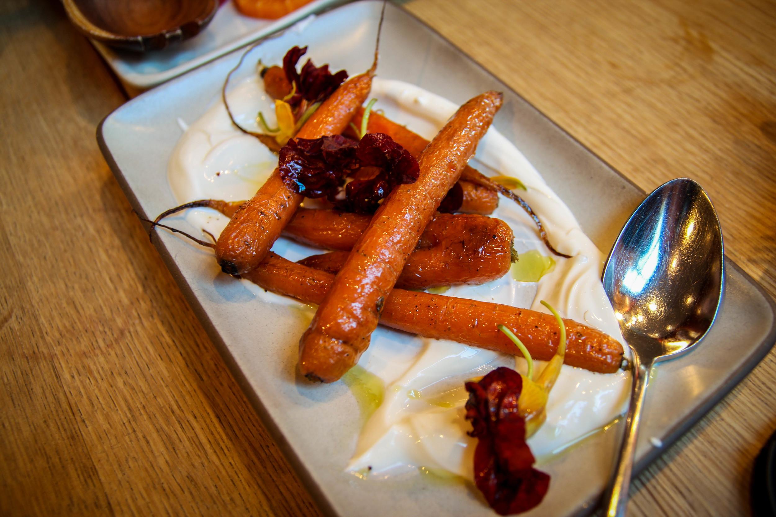 Roasted carrots with Greek yogurt, lemon verbena, and nasturtium flowers