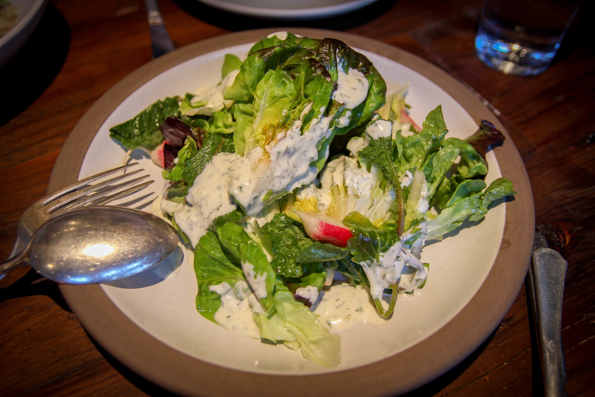 Gem lettuce salad with ramp'eh, radish, and croutons