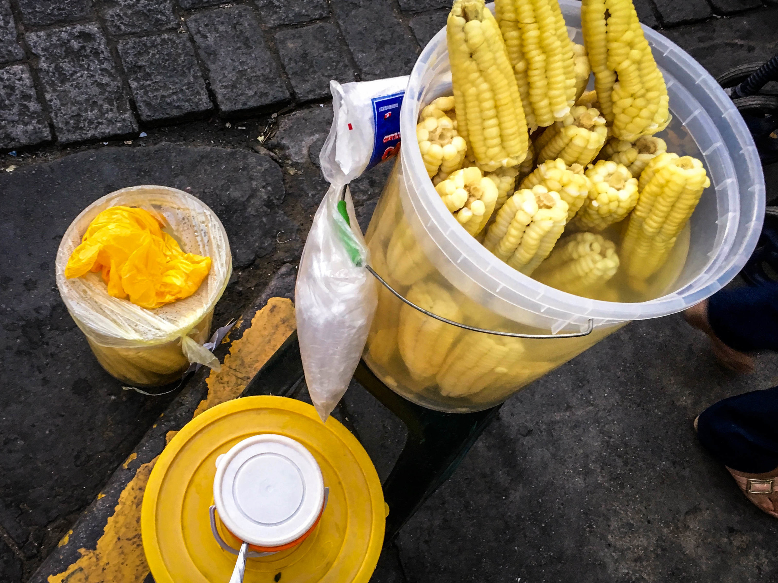 Boiled corn with butter is a popular street snack. The kernals are thick and juicy.