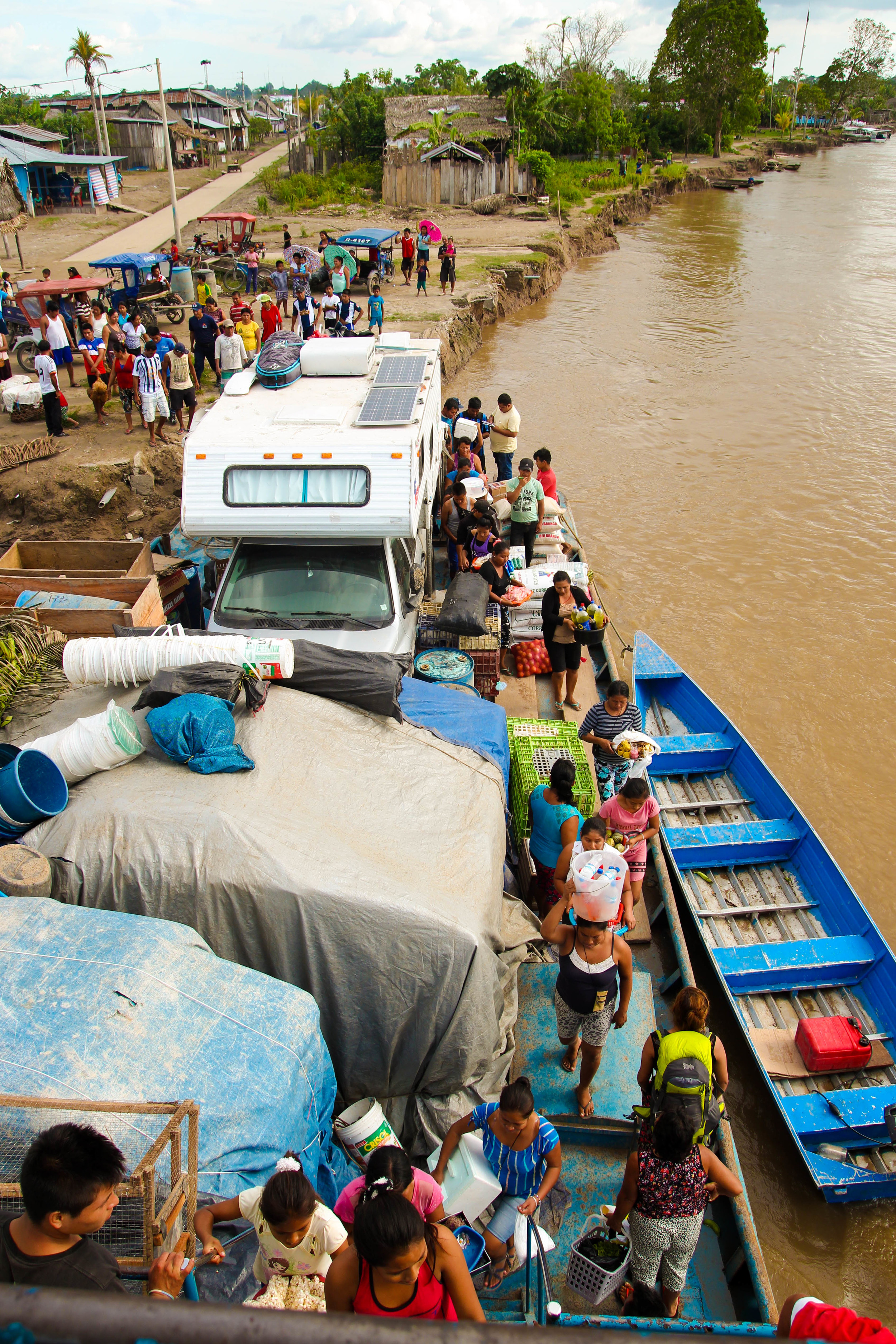 Flow of people on and off of the boat while docked at a village along the Amazon River.