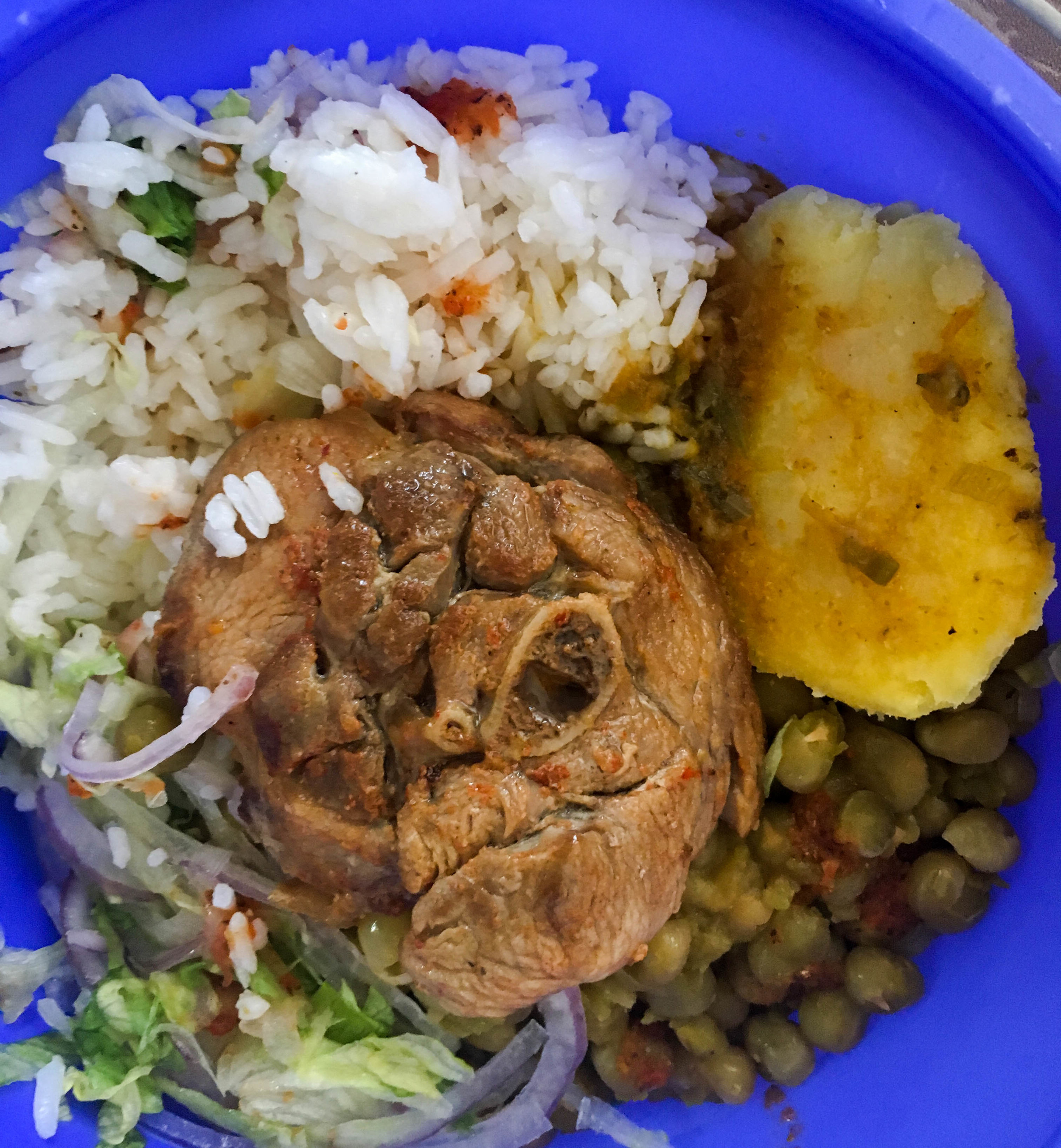 Sometimes I bring tuberware and take my food to go. On this day I ate pavita frita (fried turkey) with peas, potatoes, and rice.