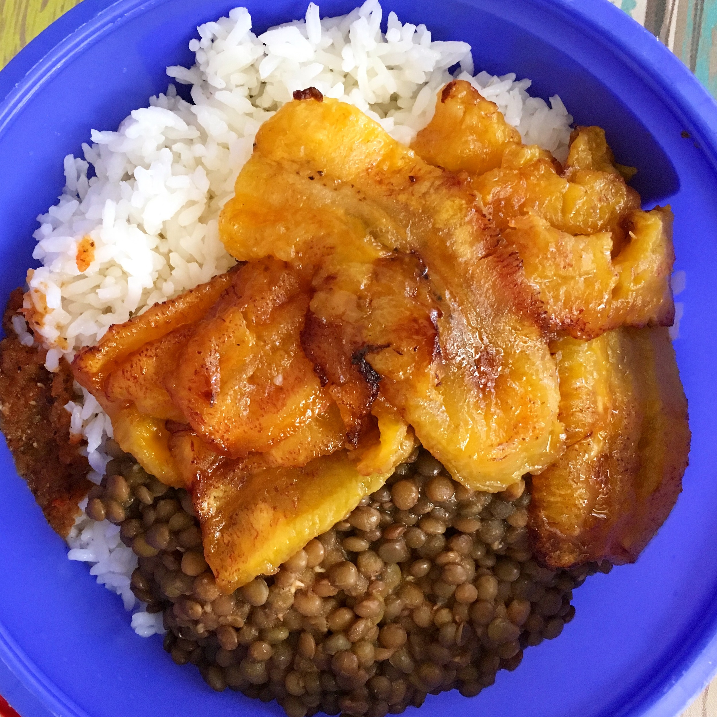 A vegetarian meal of lentils, rice and fried plantains. This was a special request, as none of her main courses come without meat.