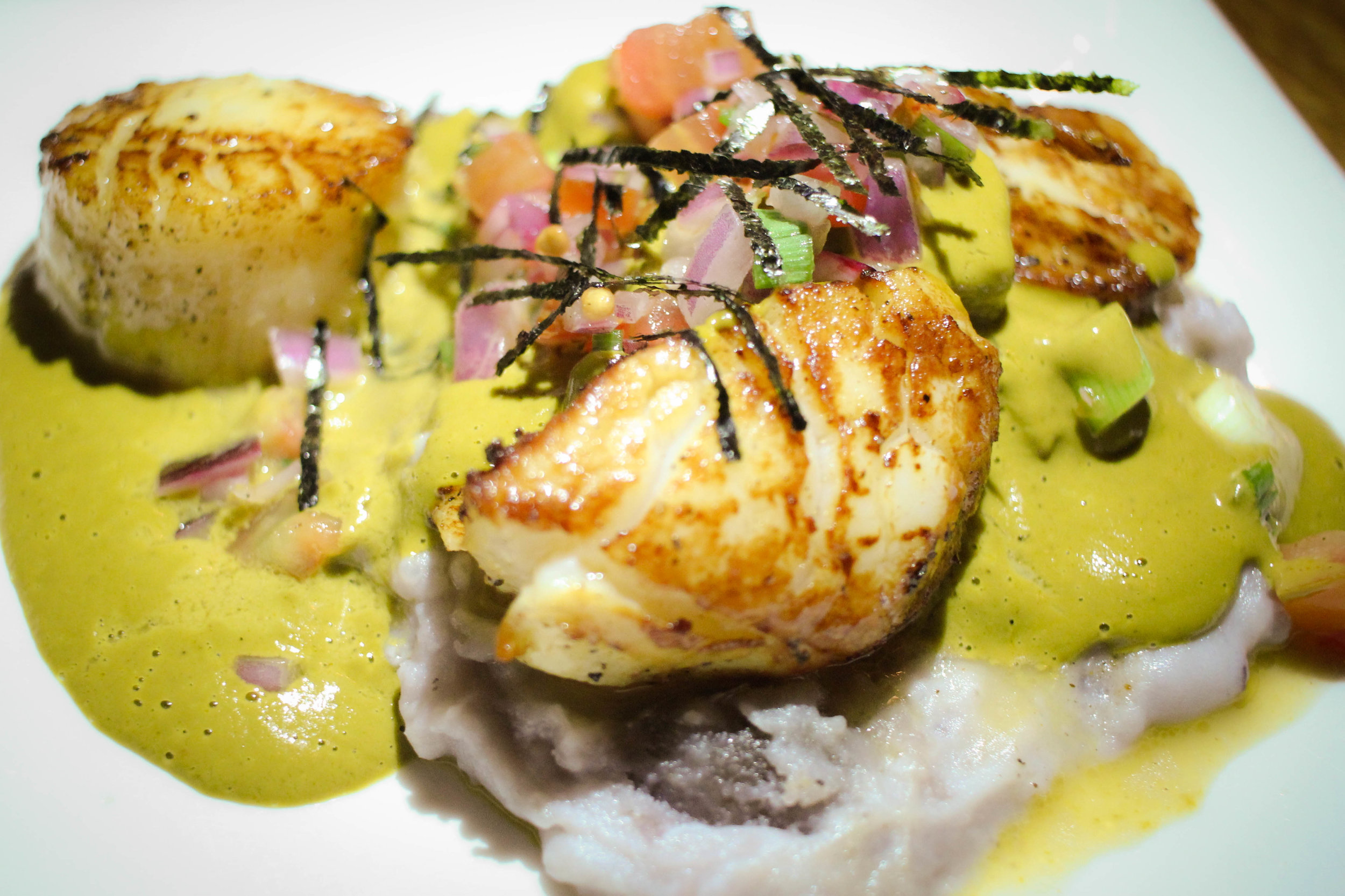 Scallops Fisho: Day boat scallops pan seared with blue mashed potatoes, sarsa panchita.
