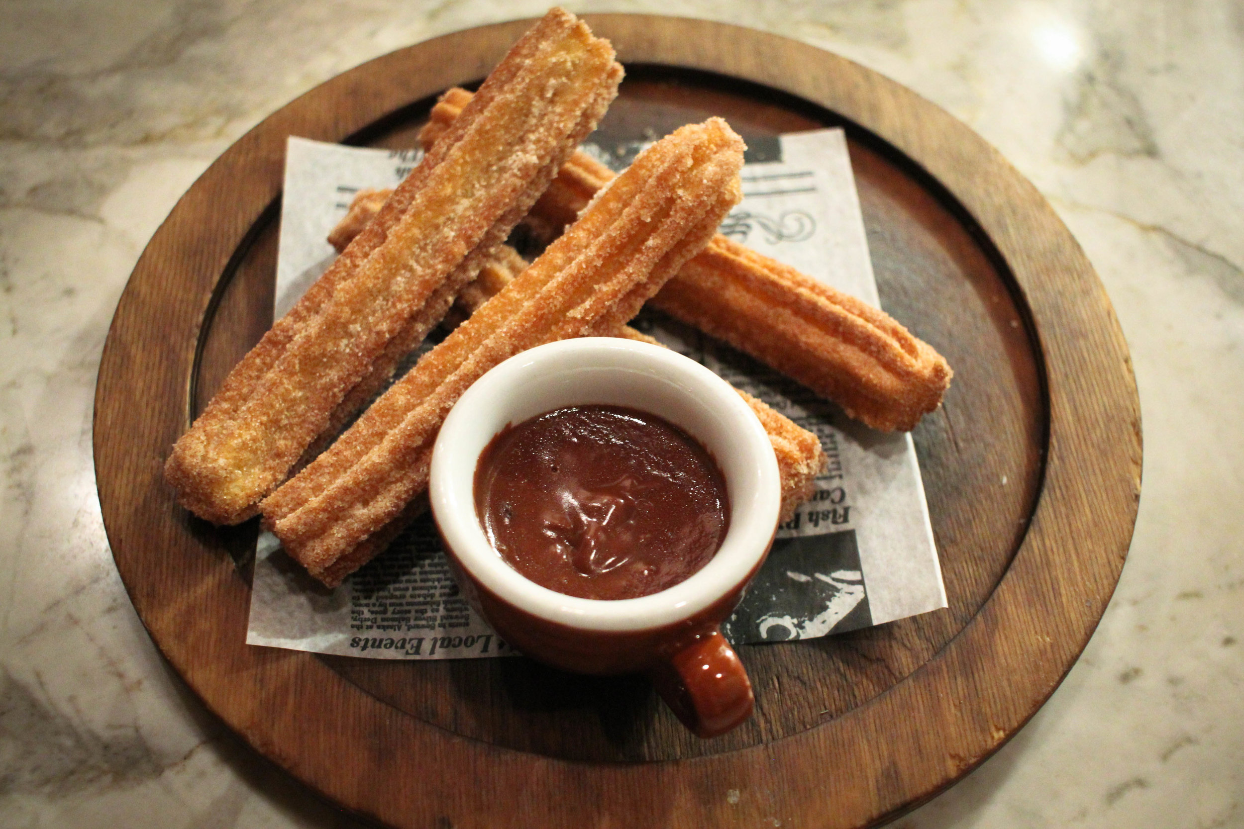 Churros with a dark chocolate dip flavored with coffee and a hint of citris