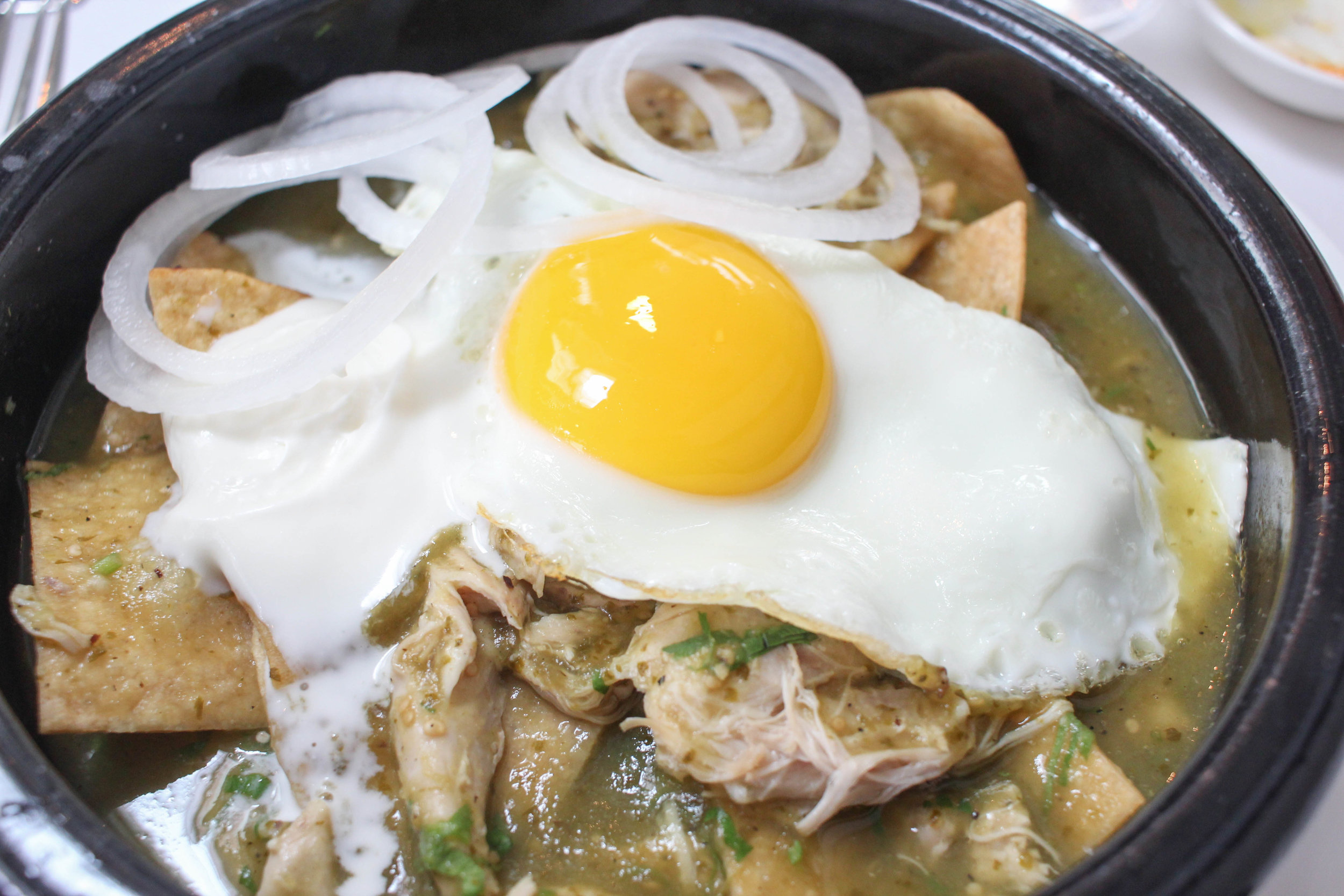 Chilaquiles verdes with chicken and a fried egg