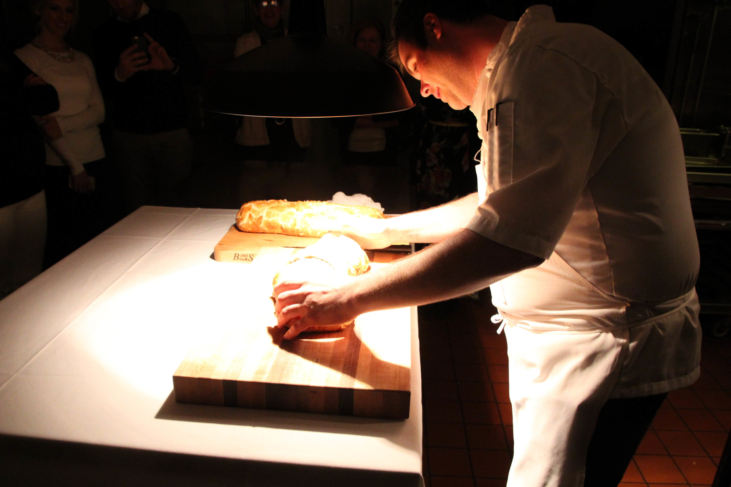 Slicing open the baked beef Wellington
