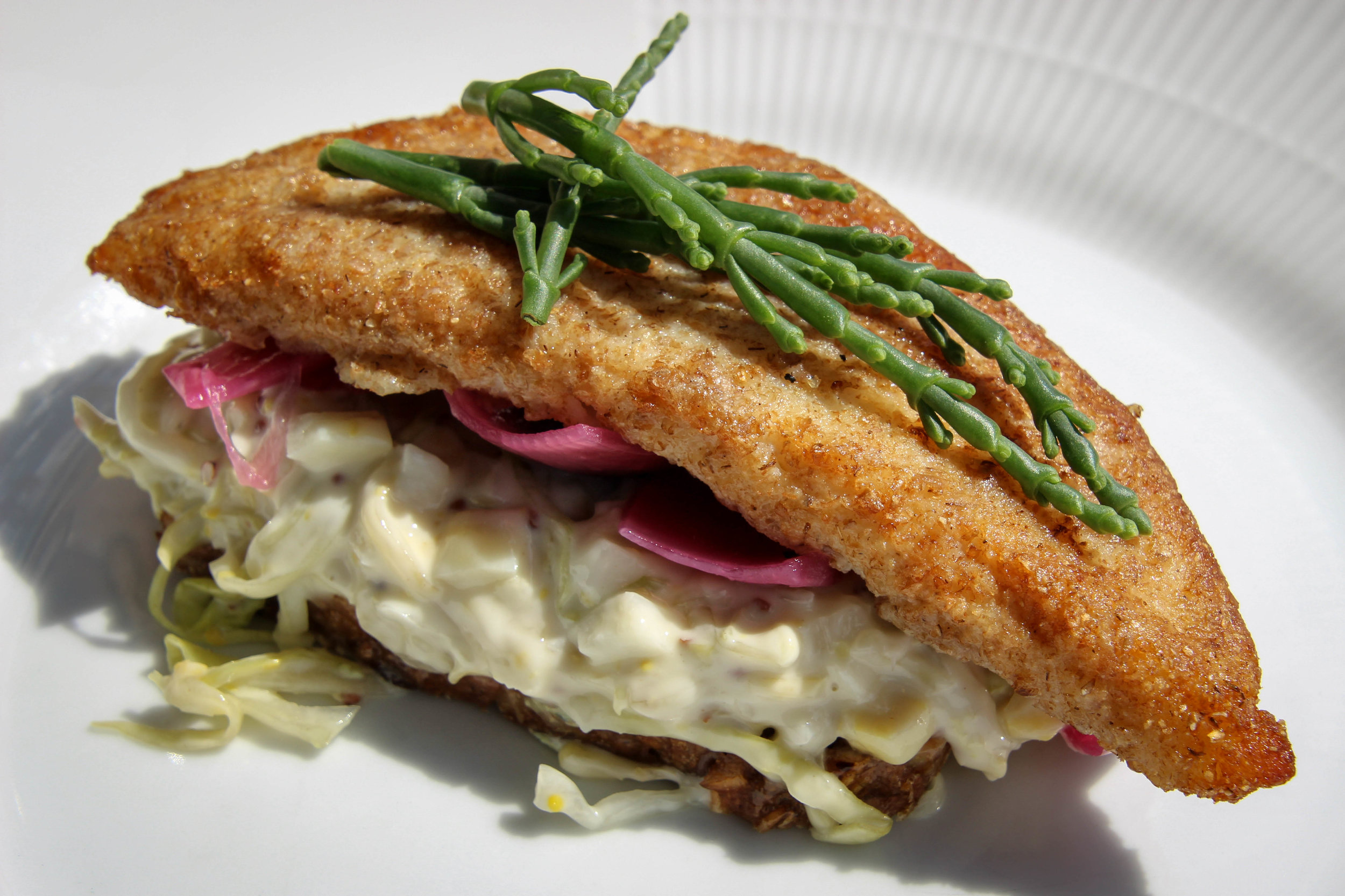 Fish fillet with pickled cabbage, glasswort and creamy kale